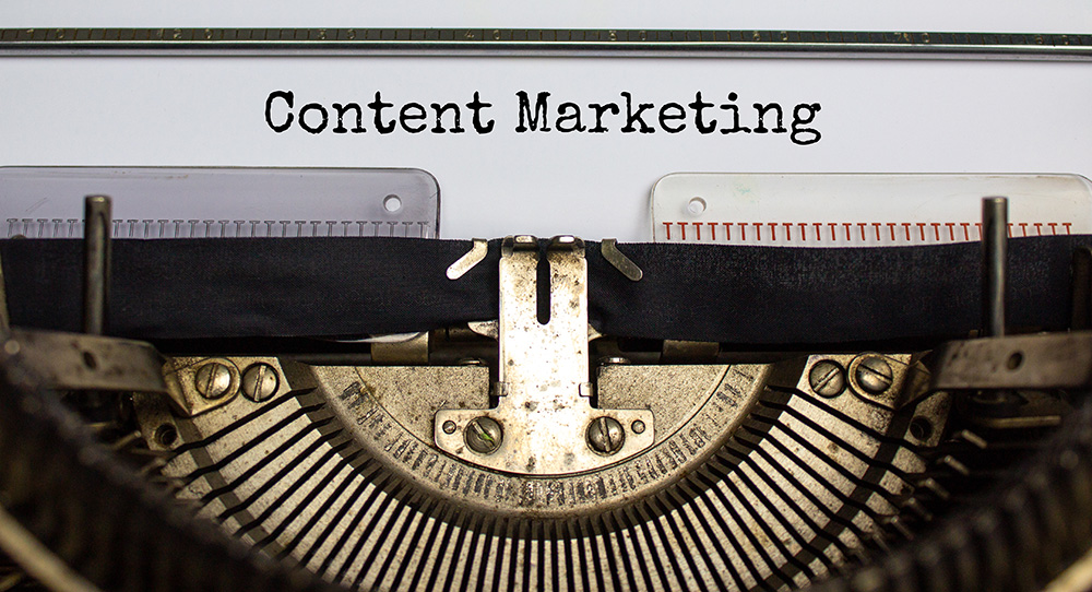 typewriter with content marketing typed out